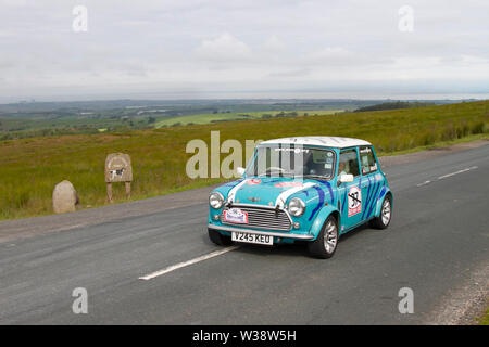 Rover Mini Cooper Sport at Scorton, Lancashire. UK Weather 13th July, 2019. Sunny conditions as the Lancashire Car Club Rally Coast to Coast crosses the Trough of Bowland. 74 vintage, classic, collectible, heritage, historics vehicles left Morecambe heading for a cross county journey over the Lancashire landscape to Whitby. A 170 mile trek over undulating landscape as part of the classics on tour car club annual event. Credit: MediaWorldImages/Alamy Live News - Stock Photo