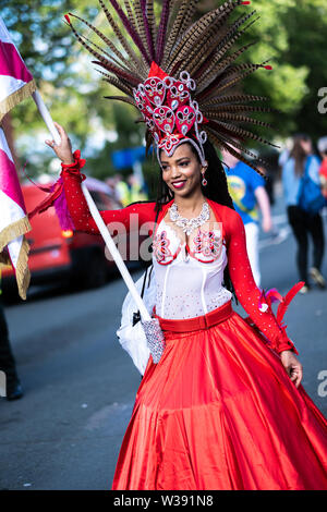 Liverpool, UK. 13th July, 2019. Brazilica Festival carnival parade, which is the largest celebration of Brazilian culture in the United Kingdom, has taken place on Saturday, July 13, 2019 in Liverpool, in the north west of England. The event has been held annually since 2008 and attracts thousands of spectators. Credit: Christopher Middleton/Alamy Live News - Stock Photo