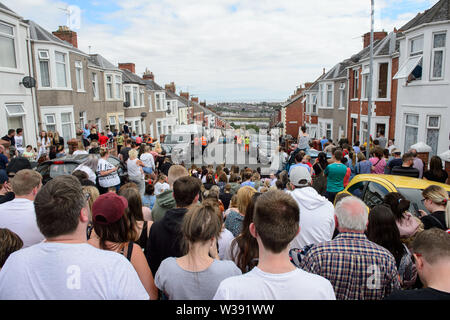 Barry, UK. 13th July, 2019. Crowds gather in the street to watch the filming of the BBC Comedy Gavin & Stacey Christmas special in Trinity Street, Barry, South Wales. Credit: Mark Lewis/Alamy Live News - Stock Photo