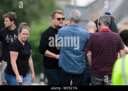 Barry, UK. 13th July, 2019. Co-writer and star James Corden who plays 'Smithy' on the set of the BBC Comedy Gavin & Stacey Christmas special which is filming in Trinity Street, Barry, South Wales. Credit: Mark Lewis/Alamy Live News - Stock Photo