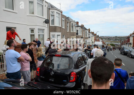 Barry, UK. 13th July, 2019. Crowds gather to watch the filming of the BBC comedy Gavin & Stacey Christmas special in Trinity Street, Barry, South Wales. Credit: Mark Lewis/Alamy Live News - Stock Photo