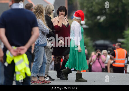 Barry, UK. 13th July, 2019. Co-writer Ruth Jones who plays 'Nesa' and Joanna Page who plays 'Stacey' rehearse a scene  whilst filming the BBC comedy Gavin & Stacey Christmas special in Trinity Street, Barry, South Wales. Credit: Mark Lewis/Alamy Live News - Stock Photo