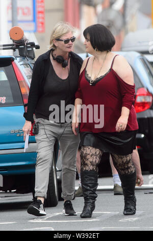Barry, UK. 13th July, 2019.  Co-writer Ruth Jones who plays 'Nesa' during filming of the BBC comedy Gavin & Stacey Christmas special in Trinity Street, Barry, South Wales. Credit: Mark Lewis/Alamy Live News - Stock Photo
