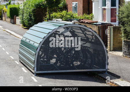 Lock up storage for bicycles in London, England United Kingdom UK - Stock Photo