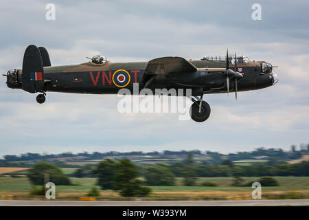 Yeovilton, UK. 13th July, 2019. A Lancaster Bomber of the Battle of Britain Memorial Flight, landing at the airshow in Yeovilton. Credit: Matthew Lofthouse/Alamy Live News - Stock Photo