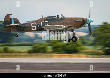 Yeovilton, UK. 13th July, 2019. A Hurricane of the Battle of Britain Memorial Flight, landing at the airshow in Yeovilton. Credit: Matthew Lofthouse/Alamy Live News - Stock Photo