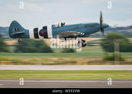 Yeovilton, UK. 13th July, 2019. A Spitfire of the Battle of Britain Memorial Flight, landing at the airshow in Yeovilton. Credit: Matthew Lofthouse/Alamy Live News - Stock Photo