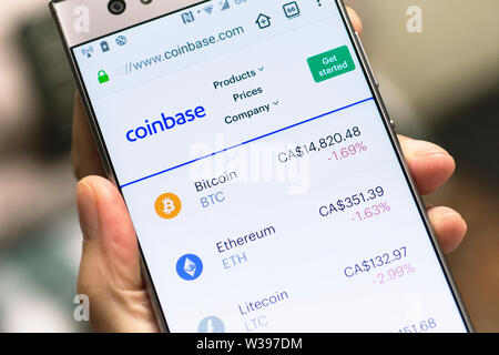 Coinbase Webiste , Bitcoin, Ethereum, Litecoin Cryptocurrency screen on Android Smartphone Mobile Phone - Stock Photo