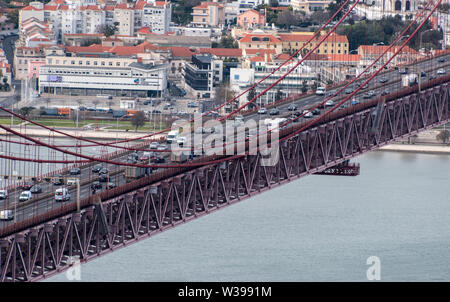 Traffic crossing the 25 de Abril Bridge in Lisbon, Portugal - Stock Photo