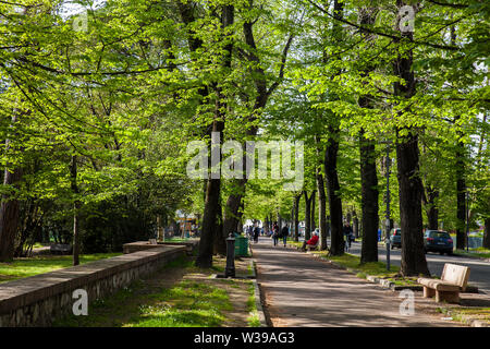 PISA, ITALY - APRIL, 2018: Walking and biking path of the Viale delle Piagge an street located on the eastern outskirts of the city along the right ba - Stock Photo