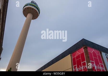 Liverpool, United Kingdom - April 26, 2019: Radio City Tower or St. John's Beacon, a radio and observation tower in Liverpool built in 1969, set again - Stock Photo