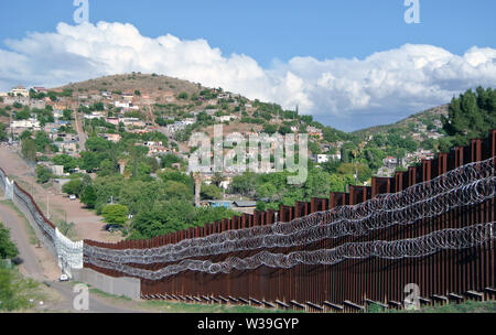 border fence in nogales arizona on mexican border - Stock Photo