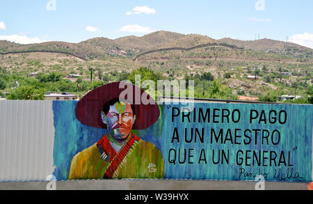 mural of general zapata in nogales arizona on the usa mexican border with the fence in the background - Stock Photo
