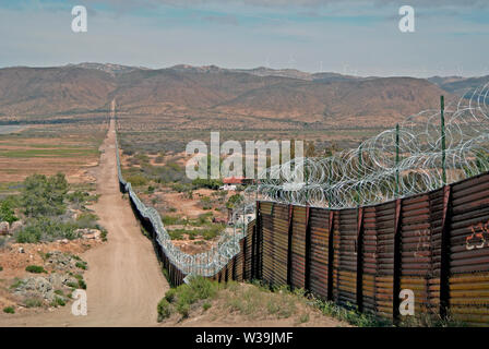 usa mexican border fence in nogales arizona - Stock Photo
