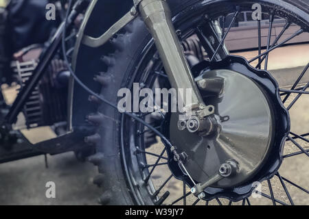 wheel Russian retro motorcycle URAL, close-up color haki - Stock Photo