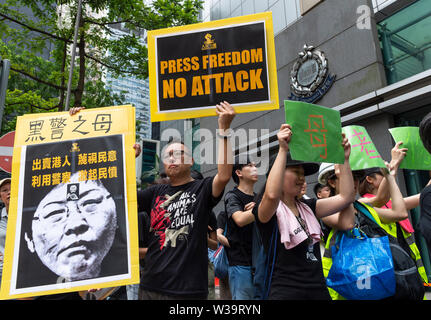 Hong Kong, China. 14th July, 2019. Silent march in Hong Kong to stop police violence and defend press freedom sees working press, journalism students and their educators both past and present gather to protest. Protesters outside the Police Headquarters. The crowd wore all black in a show of solidarity. Credit: Jayne Russell/Alamy Live News - Stock Photo