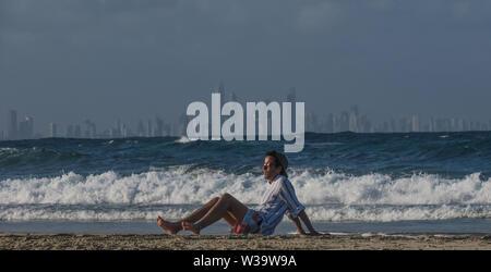 Australian beach scenes. Life's a beach in Australia sun baking in Queensland. - Stock Photo
