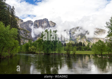 Granite mountains and water in Yosemite National Park, United States - Stock Photo