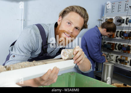 a man working on insulation - Stock Photo