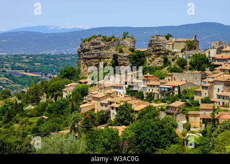 View at the village Saignon located on the rock in the Luberon mountains, Vaucluse, Provence, France.