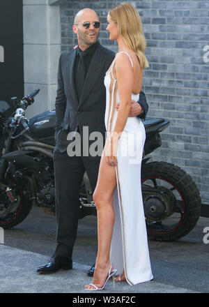 HOLLYWOOD, LOS ANGELES, CALIFORNIA, USA - JULY 13: Actor Jason Statham and partner/model Rosie Huntington-Whiteley arrive at the Los Angeles Premiere Of Universal Pictures' 'Fast & Furious Presents: Hobbs & Shaw' held at Dolby Theatre on July 13, 2019 in Hollywood, Los Angeles, California, USA. (Photo by Rudy Torres/Image Press Agency) - Stock Photo