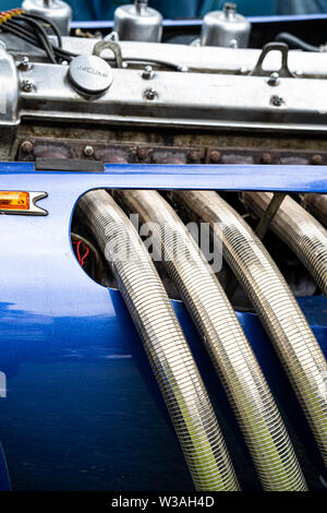 Flexible stainless steel exhaust manifold on a Jaguar V12 special.Classic cars at the Oakamoor Hill Climb, 13th July 2019, Oakamoor, Staffordshire, UK - Stock Photo