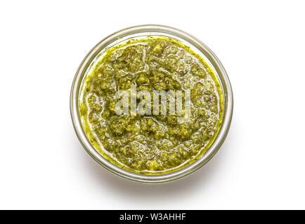 Top View of Italian Sauce Pesto or bowl of Basil Pesto isolated on white Background - Stock Photo
