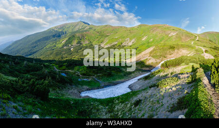 Massif of Pip Ivan with the ruins of the observatory on top. And remnants of melting snow in valley, Carpathian, Chornohora, Ukraine. - Stock Photo