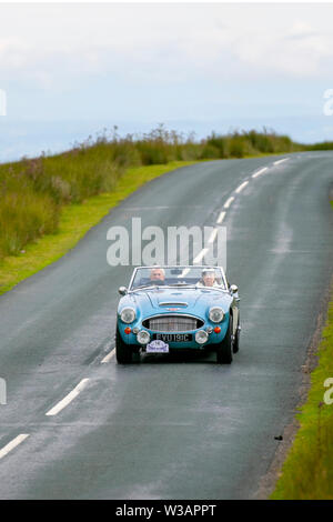 1966 Austin Healey 3000 MKIII at Scorton, Lancashire. Lancashire Car Club Rally Coast to Coast crosses the Trough of Bowland. 74 vintage, classic, collectible, heritage, historics vehicles left Morecambe heading for a cross county journey over the Lancashire landscape to Whitby. A 170 mile trek over undulating landscape as part of the classics on tour car club annual event. - Stock Photo