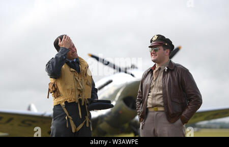 Re-enactors in Second World War military dress during the Flying Legends Air Show at IWM Duxford. - Stock Photo