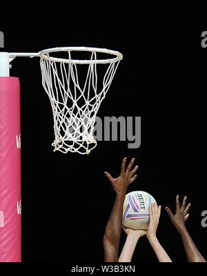 Liverpool, UK. 14 July 2019. Hands try to block a shot during the Preliminary game between Uganda and Scotland at the Netball World Cup. M and S arena, Liverpool. Merseyside. UK. Credit Garry Bowdenh/SIP photo agency/Alamy live news.