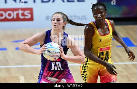 Liverpool, UK. 14 July 2019. Emily Nicholl (Scotland) and Stella Oyella (Uganda) during the Preliminary game between Uganda and Scotland at the Netball World Cup. M and S arena, Liverpool. Merseyside. UK. Credit Garry Bowdenh/SIP photo agency/Alamy live news.