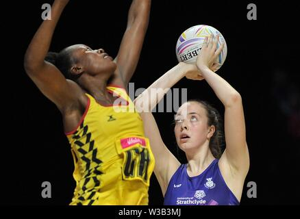 Liverpool, UK. 14 July 2019. Emma Barrie (Scotland) shoots during the Preliminary game between Uganda and Scotland at the Netball World Cup. M and S arena, Liverpool. Merseyside. UK. Credit Garry Bowdenh/SIP photo agency/Alamy live news.