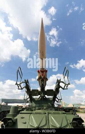 BUDAPEST/HUNGARY - 05.18, 2019: SA-6 Gainful 2K12 Kub old russian ground-to-air missile system at a defense show. Front view, wide angle, blue sky. - Stock Photo