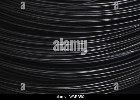 Pile of iron, metal wire rod or coil background for Construction industry. steel wire fence rolls. Steel wire tie rolls for construction and industry - Stock Photo