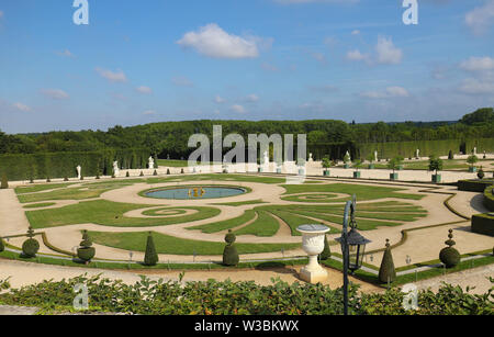 Beautiful garden in a Famous palace Versailles. The Palace Versailles was a royal castle . Paris, France. - Stock Photo