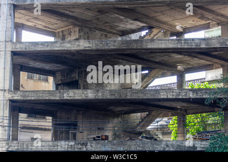 Abandoned building construction in the most central district of Bangkok, Thailand - Stock Photo