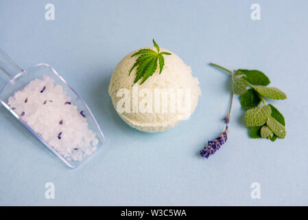 Assortment of cannabis wellness products with bath bomb, soaking salts and marijuana leaf - cannabis spa concept - Stock Photo
