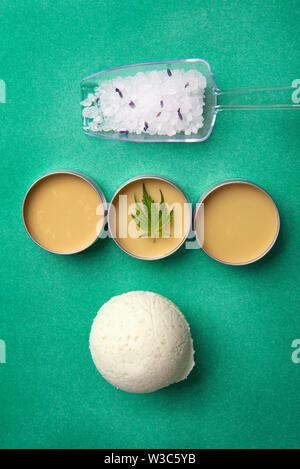 Assortment of cannabis wellness products with bath bomb, soaking salts and marijuana salve - cannabis spa concept - Stock Photo