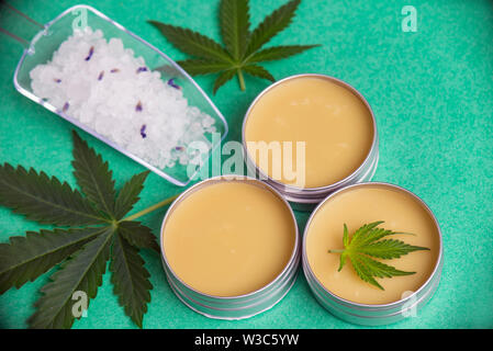 Assortment of cannabis wellness products with bath bomb, soaking salts and marijuana salve - cannabis spa concept - Stock Photo