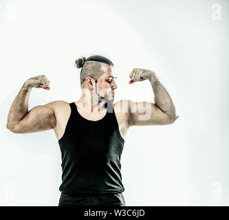 portrait - the trainer on bodybuilding shows an exercise to warm up the muscles. the photo has a empty space for your text - Stock Photo