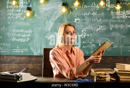 Literature lesson with grammar book. Literature as successful human future. - Stock Photo