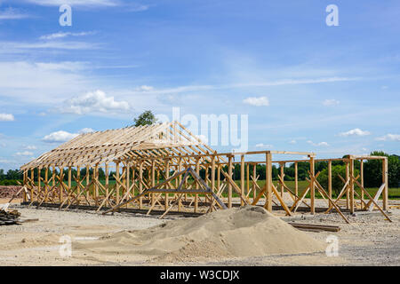 Frame of a new wooden house under construction - Stock Photo