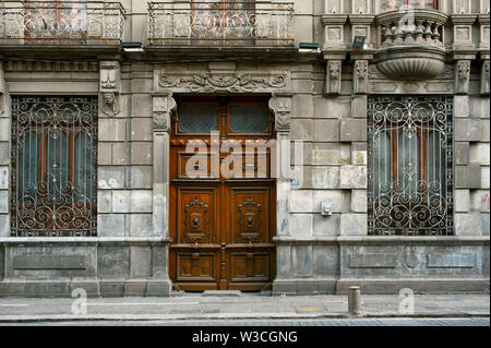 Building facade with Spanish colonial details and carved door in downtown Puebla, UNESCO World Heritage site. Puebla de Zaragoza, Mexico. Jun 2019 - Stock Photo