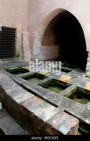 The Lavatoio Medievale is a traditional washhouse in Cefalu, Sicily,   River Cefalino water flows into the basins and out via a tunnel to the sea. - Stock Photo