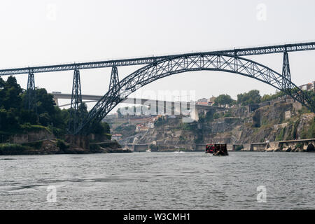 The Maria Pia Bridge (Ponte de D. Maria Pia), railway bridge over the Douro River in Porto, Portugal - Stock Photo