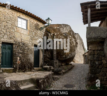 The narrow streets and rustic houses of the village of Monsanto, Portugal - Stock Photo