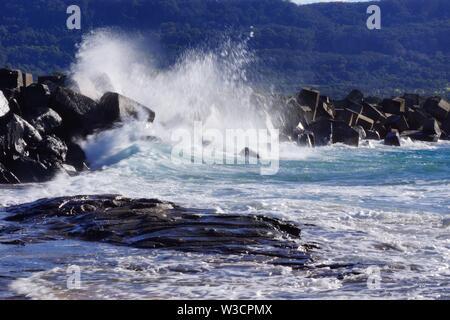 Waves crashing on rocks - Stock Photo