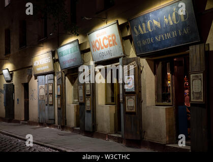 Street scene showing row of shops with Jewish theme. Photo is taken in Kazimierz, once the historic Jewish quarter, Krakow, Poland - Stock Photo
