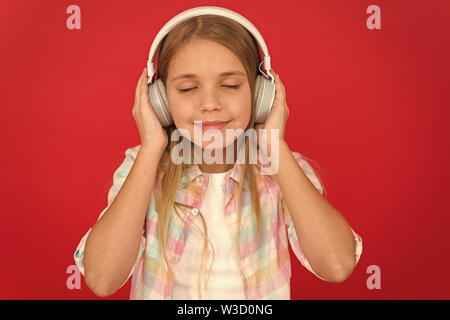 childrens day. Audio technology. Childhood happiness. Mp3 player. small girl child in headphones. small kid listen ebook, education. Listen to music. Beauty and fashion. Searching for favorite music. - Stock Photo